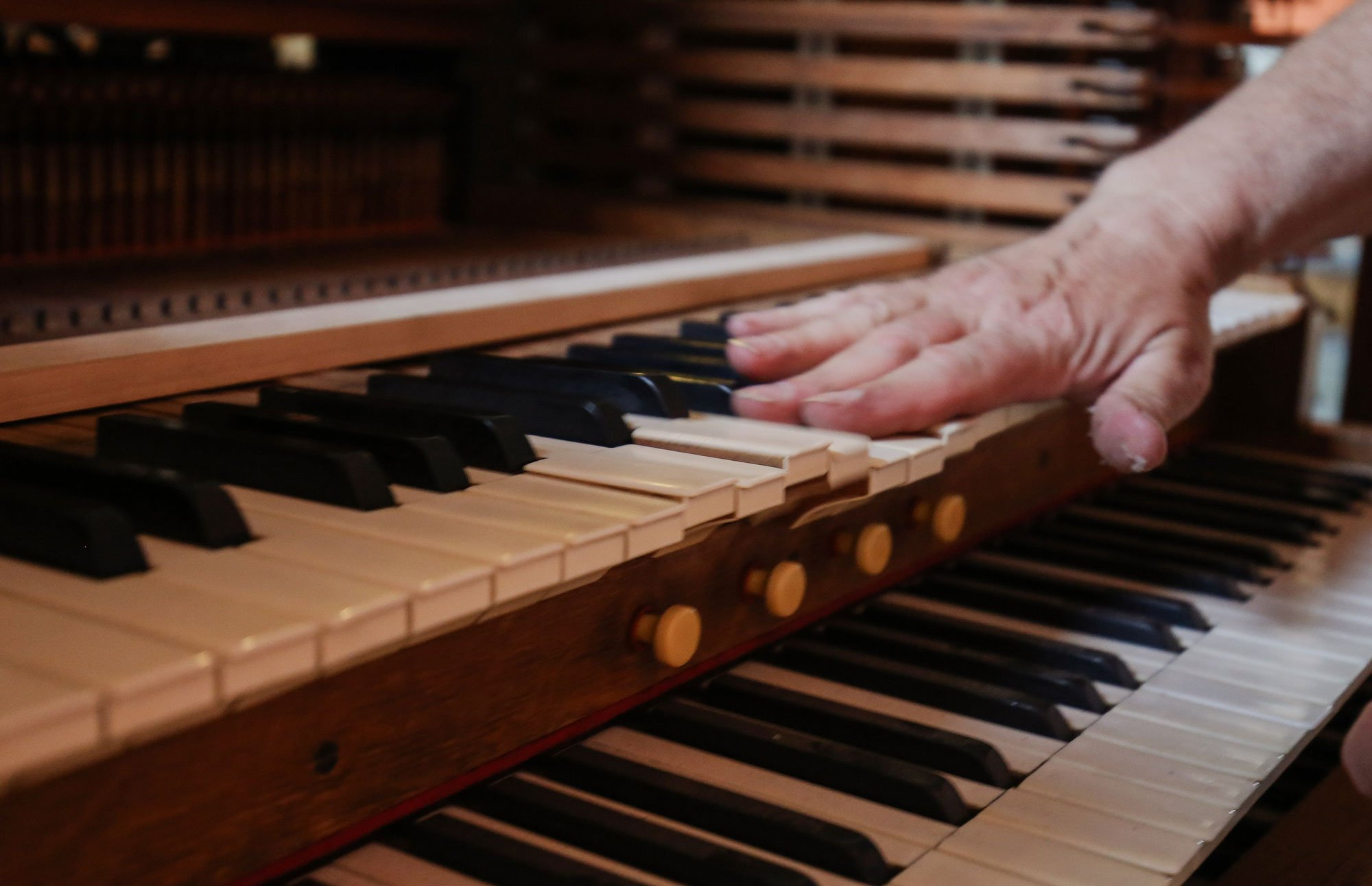 Restorers' Hands On Organ Keyboard